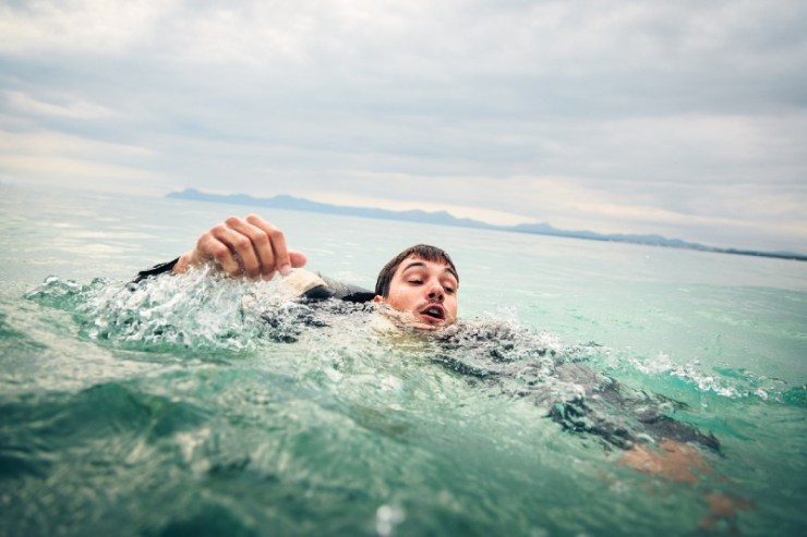 Businessman Drowning in the Sea-sea survival