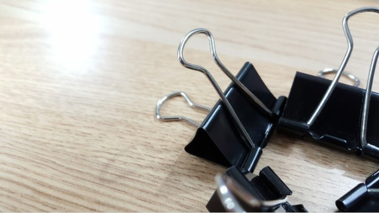 Set of office clips for paper on a white background-binder clips