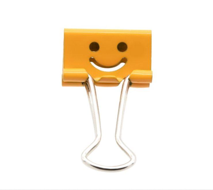 Smile orange binder clip isolated on white background-binder clips