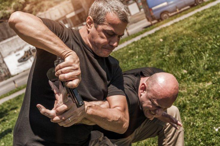 Kapap instructor demonstrates self defense techniques against a gun   gentleman's technique