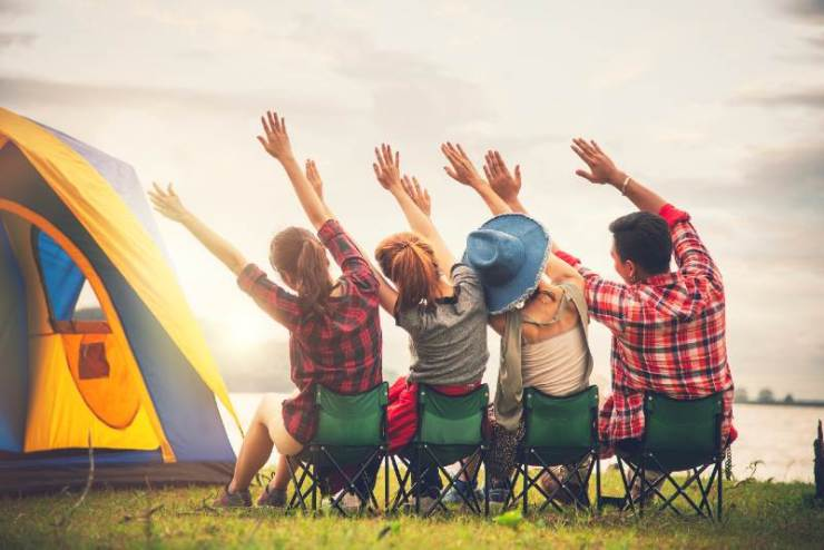 Group of Young Asian Camper Enjoy Camping Outdoors Party with Friends Near the Lake in the Forest-Camping Without Electricity