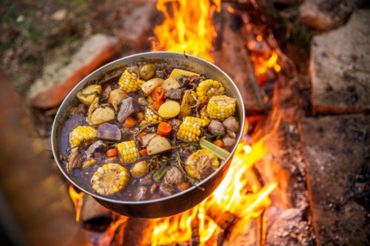cooking-over-campfire-stewed-food | camp stew