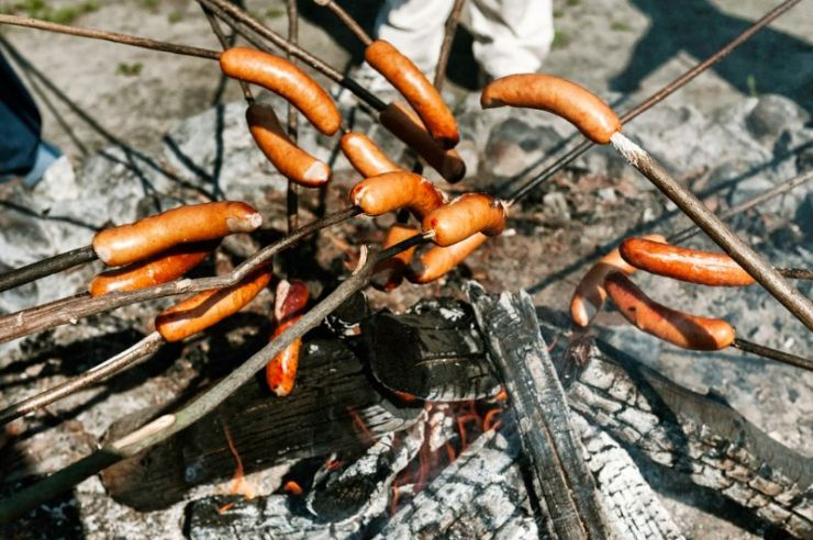 sausages-baked-on-campfire-forest-making | sausages