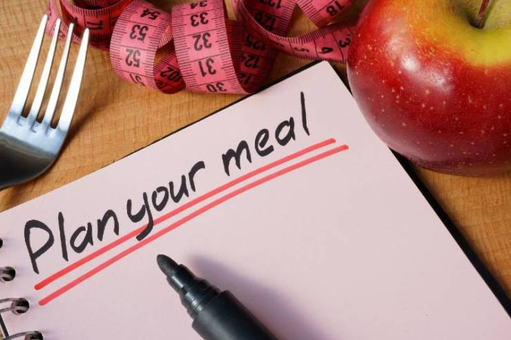 Diary with a record plan your meal on a table-Simple Packing Tips