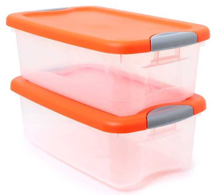 Orange and clear plastic storage container bins stacked over white background-Simple Packing Tips