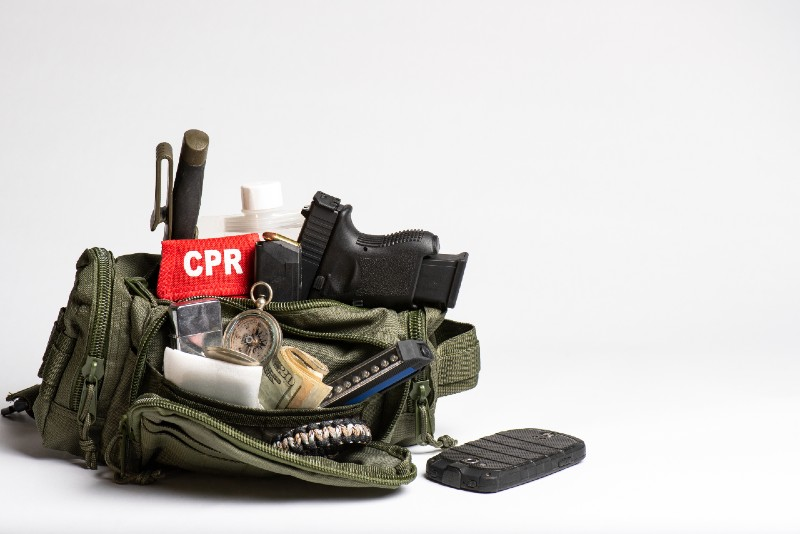 Survival travel kit, small, light, simple bugout bag with medical, weapons, GPS, compass-prepping for shtf