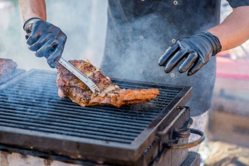 bbq-ribs-hands-gloves-overtake-fried grill