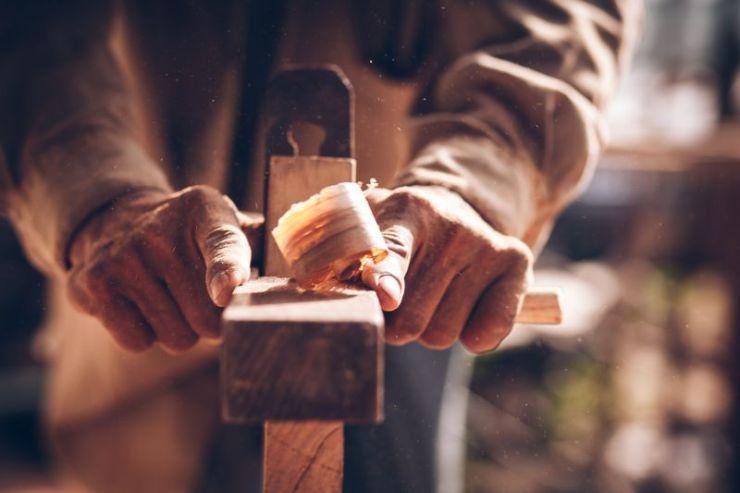 carpenters-using-spokeshave-decorate-woodwork   carpentry