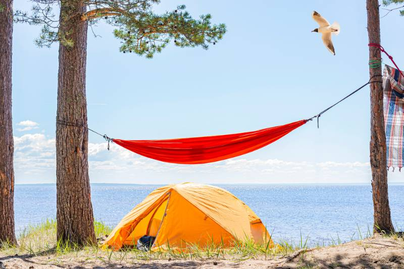 tent-hammock-on-beach-tented-tourist camping