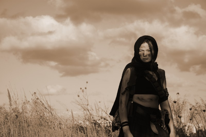 A female militia soldier in a post apocalyptic desert wasteland-Survival Skills