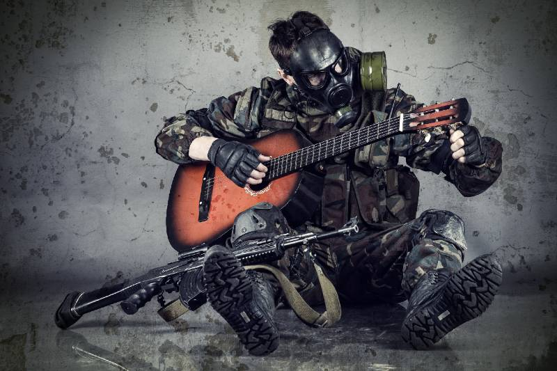 man in gas mask plays guitar-Survival Skill set