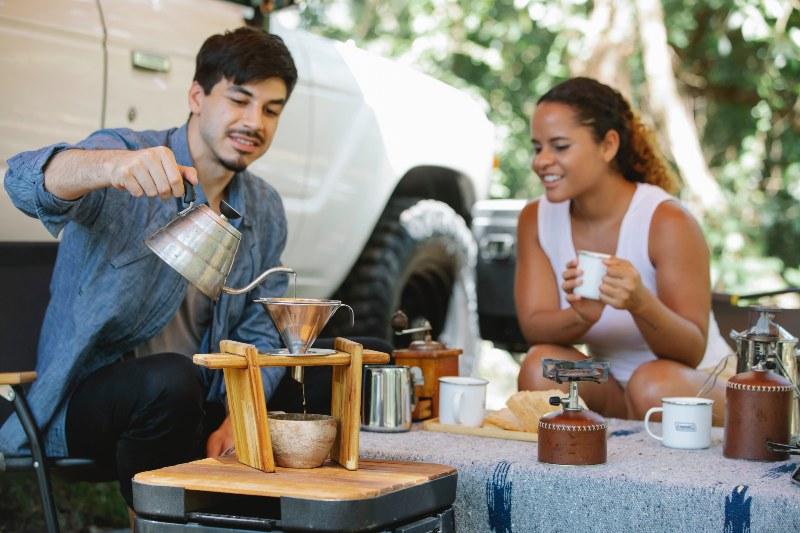 Couple Preparing Pour-Over Coffee During Picnic | Camping Food Hacks