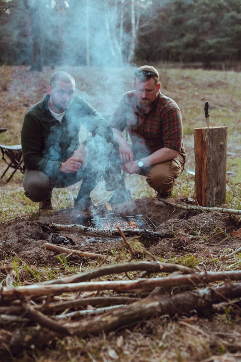 two-friends-sitting-near-campfire-behind How to get rid of mosquitoes