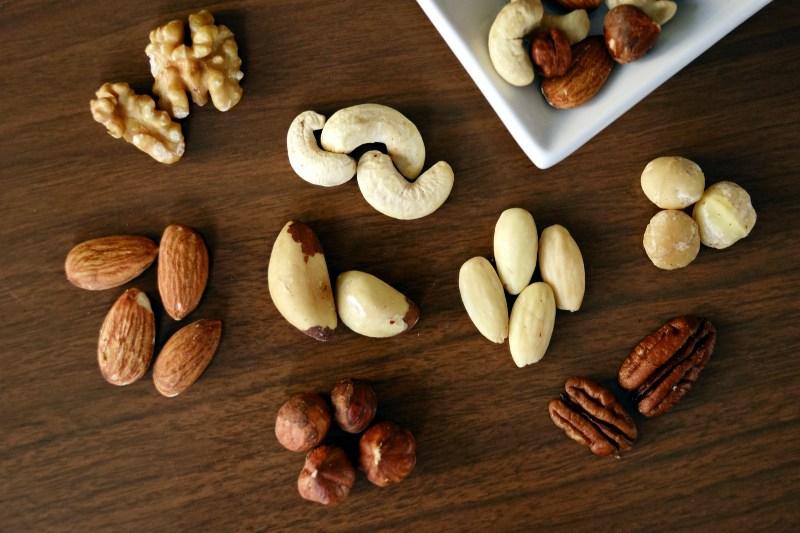 Variety of Brown Nuts on Brown Wooden Panel | Camping Food Hacks